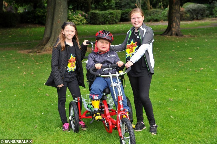 Mollie Lyon, 11, and Caitlyn Docherty, 11, have raised money for a specially designed bike for Declan Shillito, who suffers from developmental growth disability, pictured is Declan on his new bike with Caitlyn, left, and Mollie. See Ross Parry copy RPYHEROES : In a touching tale of selfless sacrifice, two schoolgirls have given up their free time to raise money to buy a disabled five-year-old a specially adapted bike. While their pals were out playing, inspirational 11-year-olds Mollie Lyon and Caitlyn Docherty were doing charity bike rides and hosting fundraising football matches to help out little Declan Shillito. Declan, who suffers from a developmental growth disorder, has never had a bike before - and was over the moon when the girls presented him with his very own wheels, worth . The girls raised an impressive total of #1,139.15, and will donate the rest of the money to the All Ride charity - which provides bikes and cycling facilities for disabled children.