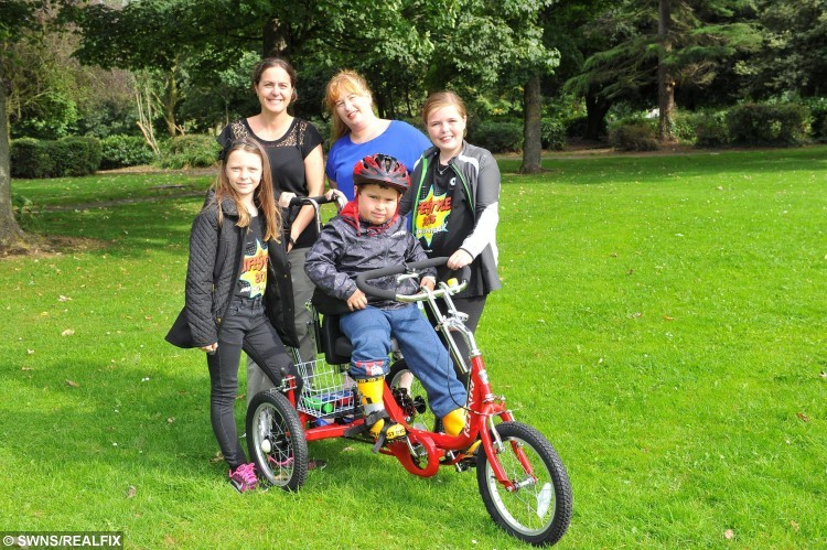 Mollie Lyon, 11, and Caitlyn Docherty, 11, have raised money for a specially designed bike for Declan Shillito, who suffers from developmental growth disability, pictured is Declan on his new bike with, from left, Caitlyn, Mollies mother Melanie Lyon, Declans mother Claire Shillito and Mollie. See Ross Parry copy RPYHEROES : In a touching tale of selfless sacrifice, two schoolgirls have given up their free time to raise money to buy a disabled five-year-old a specially adapted bike. While their pals were out playing, inspirational 11-year-olds Mollie Lyon and Caitlyn Docherty were doing charity bike rides and hosting fundraising football matches to help out little Declan Shillito. Declan, who suffers from a developmental growth disorder, has never had a bike before - and was over the moon when the girls presented him with his very own wheels, worth . The girls raised an impressive total of #1,139.15, and will donate the rest of the money to the All Ride charity - which provides bikes and cycling facilities for disabled children.