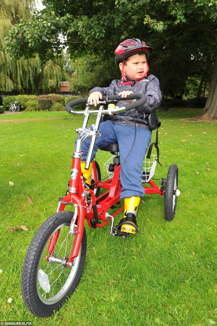 The Brilliant Bikers Mollie Lyon, 11, and Caitlyn Docherty, 11, have raised money for a specially designed bike for Declan Shillito, who suffers from developmental growth disability, pictured is Declan on his new bike. See Ross Parry copy RPYHEROES : In a touching tale of selfless sacrifice, two schoolgirls have given up their free time to raise money to buy a disabled five-year-old a specially adapted bike. While their pals were out playing, inspirational 11-year-olds Mollie Lyon and Caitlyn Docherty were doing charity bike rides and hosting fundraising football matches to help out little Declan Shillito. Declan, who suffers from a developmental growth disorder, has never had a bike before - and was over the moon when the girls presented him with his very own wheels, worth . The girls raised an impressive total of #1,139.15, and will donate the rest of the money to the All Ride charity - which provides bikes and cycling facilities for disabled children.