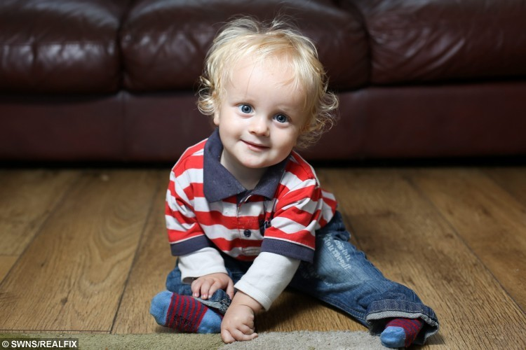 16-month-old Issac Ketley photographed at his home in Hull, East Yorkshire. 21-year-old mum Francesca, who was told her young son may never walk, has been given a lifeline by a generous charity who has provided her with a special harness so he can walk on her toes. See Ross Parry copy RPYWALK. A mum who was told her young son may never walk has been given a lifeline by a generous charity who has provided her with a special harness so he can walk on her TOES. Francesca Ketley, 21, gave birth to 16-month-old Issac four weeks early and she became concerned about his developmental milestones after a few months.