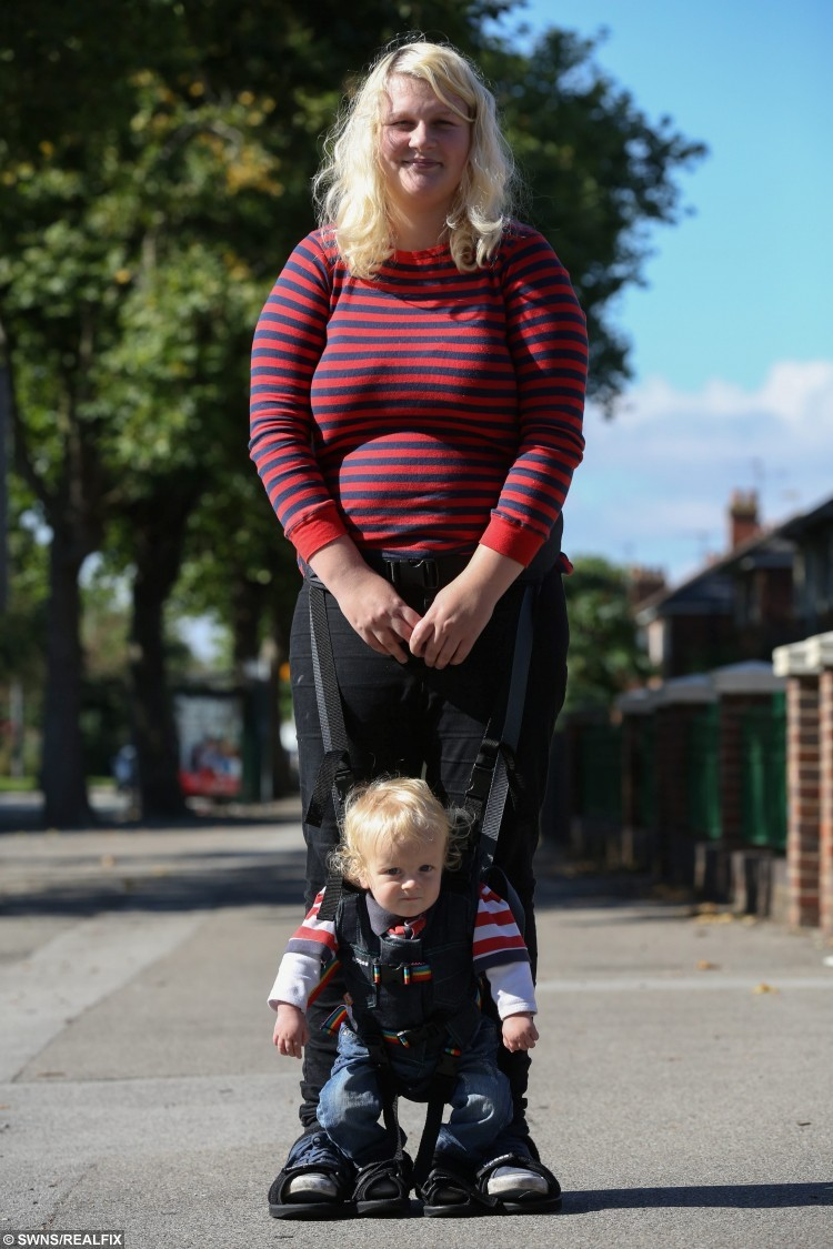 Francesca Ketley with her 16-month-old son Issac near their home in Hull, East Yorkshire. 21-year-old Francesca, who was told her young son may never walk, has been given a lifeline by a generous charity who has provided her with a special harness so he can walk on her toes. See Ross Parry copy RPYWALK. A mum who was told her young son may never walk has been given a lifeline by a generous charity who has provided her with a special harness so he can walk on her TOES. Francesca Ketley, 21, gave birth to 16-month-old Issac four weeks early and she became concerned about his developmental milestones after a few months.