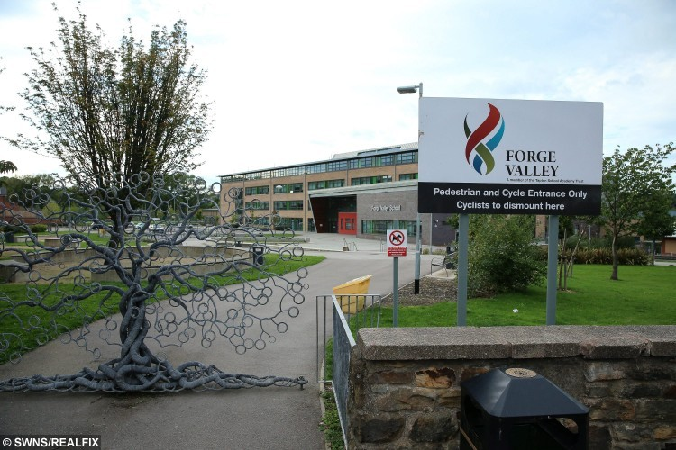 Forge Valley School in Stannington, Sheffield.  See rossparry copy RPYHAIR: The mother of a schoolgirl who was sent home for her leopard-print hairstyle is slamming the decision - as a breach of her human rights. Yvonne Mcdowell, 34, has hit out after her 13-year-old daughter, Lauren, was sent home on the first day of the new term. Now the mum is refusing to change Lauren's leopard print hairstyle as she believes it breaches her daughter's human rights.The hairstyle is shaved on one side of Lauren's head which is dyed brown and blond.