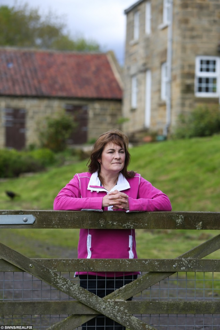 Mandy Dunford outside her home in Middlesbrough. Mandy was stalked by her neighbour who has been released for prison without a restraining order. Police have offered Mandy money to increase security at her home 19 May 2015