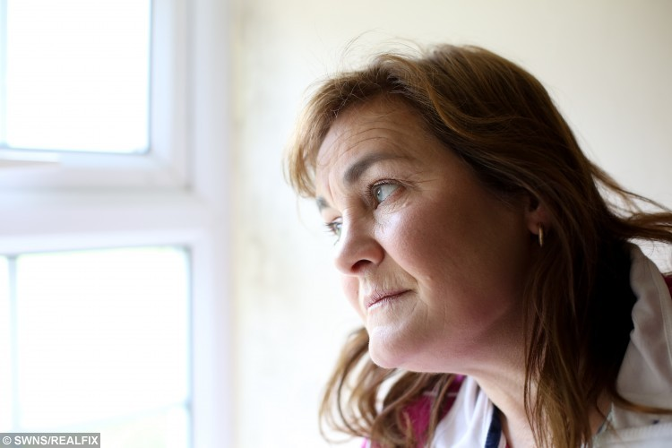 Mandy Dunford by the window in her home in Middlesbrough where her neighbour used to stalk her outside. Mandy was stalked by her neighbour who has been released for prison without a restraining order. Police have offered Mandy money to increase security at her home 19 May 2015