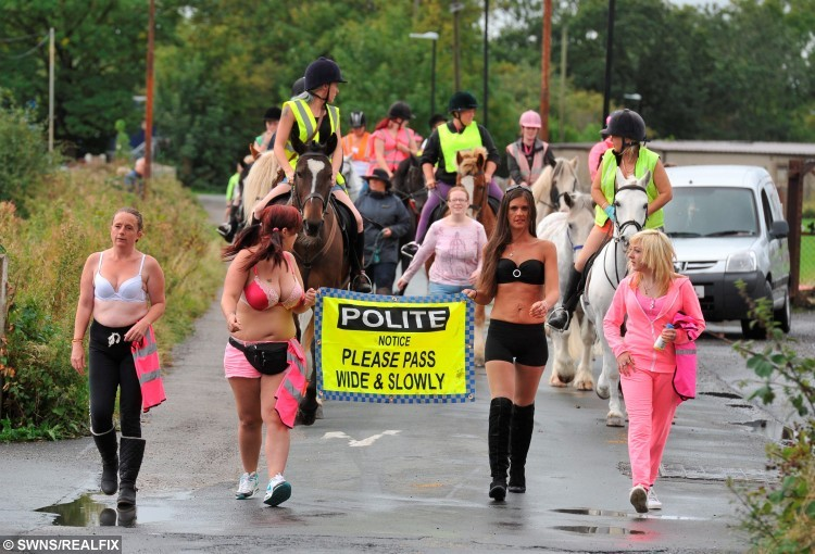 """Naked"" horse riders, parading through Morecambe for the Slow Down for My Horse Campaign. See Ross Parry copy RPYNAKED : Dozens of horse riders have taken to the streets in protest while SEMI-NAKED. More than 50 riders stripped down in support of a campaign to highlight road safety dangers horse riders face. Sonia Withers, 49, whose horse Rocky had to be put down after they were hit by a car 13 years ago, said driversà attitudes have not changed since Rocky was killed in Lancaster, Lancs., over a decade ago. In an eye-raising stunt to raise she joined the protesters on the streets of Morecambe, Lancs., on Saturday."