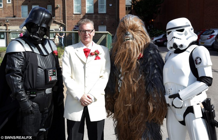 Lee Bowder and Pip Stephenson at their Star Wars themed wedding in Chesterfield. Lee Bowder with darth Vader, Chewbacca and a Stormtrooper. See Ross Parry copy RPYSTAR : The force was strong at Chesterfield Registry Office on Friday when a cast of characters from a galaxy far, far away arrived to celebrate the wedding of two of their own. A stormtrooper stood guard as a wookie, two Darth Vaders, an Imperial Guard and a Princess Leia arrived along with many other guests more traditionally attired. Fulfilling their destiny were Lee Bowder and Pip Stephenson from Selstone, who are both active members of the East Midlands Garrison, a Star Wars Ãcosplayà organisation based in Derby. Groom Lee Bowdler, dressed immaculately in a cream jacket and red cravat, said: ÃI just thought it would be nice for the area and might put a smile on people's faces.