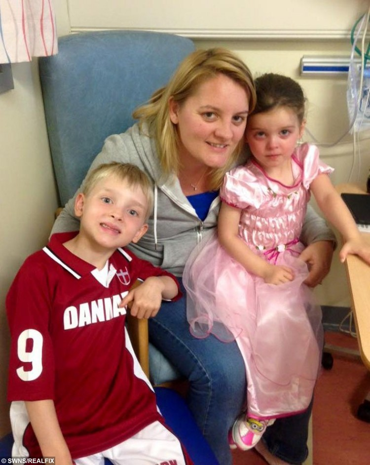 Collect of Amanda Stewart, 33, from Carluke, South Lanarkshire, after operation, with son Callan, 7 and daughter Erryn, 4, who cut her chances of getting breast cancer from 97 per cent to five per cent after undergoing a double mastectomy. See CENTRE PRESS story CPSCARS; A mum who had a double mastectomy to slash her risk of developing cancer has shared powerful images of her scars online to help others going through Amanda Stewart cut her chances of getting breast cancer from 97 per cent to five per cent after undergoing the operation six weeks ago. The 33-year-old from Carluke, South Lanarkshire, is proud of her body and hopes that she can be a role model for people who are apprehensive about getting the op. A topless image of Amanda after the preventative surgery has been viewed thousands of times since being posted last week. Hundreds of people from across the globe are following her progress through her Facebook page ÃCancer. You Loseà following her operation on August 6.