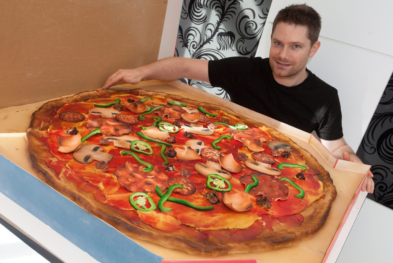 This GIANT pizza isn't quite what it seems…