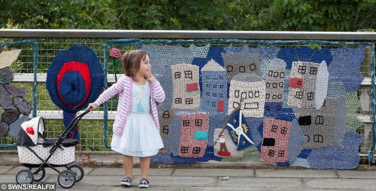 "Three-year-old Faye Pearse with knitted art in Selkirk.  Women from Selkirk, Ettrickbridge and Yarrow, in the Scottish Borders who are a team of ""guerrilla knitters"" have decorated local landmarks with crochet and knitted art. See Centre Press story CPKNIT. A 104 year old knitter who has Ãyarn bombedà her local town is thought to be the world's oldest street artist. Grace Brett is a member of a secret band of guerilla knitters, who have bedecked their town in artful knitting. Called the Souter Stormers, the group hit various landmarks in Selkirk, Borders, with their yarn work last week, following hours of preparation.  Members of the yarn bombing team are mainly over 60, but Grace à the oldest à has lived over a century."