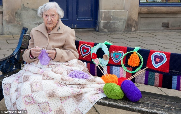"Grace Brett who is 104 and possibly the countries oldest street artist. Women from Selkirk, Ettrickbridge and Yarrow, in the Scottish Borders who are a team of ""guerrilla knitters"" have decorated local landmarks with crochet and knitted art. See Centre Press story CPKNIT. A 104 year old knitter who has Ãyarn bombedà her local town is thought to be the world's oldest street artist. Grace Brett is a member of a secret band of guerilla knitters, who have bedecked their town in artful knitting. Called the Souter Stormers, the group hit various landmarks in Selkirk, Borders, with their yarn work last week, following hours of preparation.  Members of the yarn bombing team are mainly over 60, but Grace à the oldest à has lived over a century."