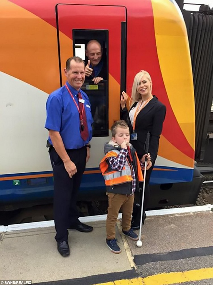 "Plucky Malachi Tyler on his dream trip to 'drive' a train. See SWNS story SWTRAIN: A seven-year-old lad who is blind in both eyes and has incurable brain tumours has had a dream come true à by helping to drive a TRAIN. Brave Malachi Tyler suffers from rare genetic disorder neurofibromatosis, which causes tumours to grow on his nerves, and has received chemotherapy since he was 12 months old. But courageous Malachi, from Tunbridge Wells, Kent, ticked another wish off his bucket list when South West Trains allowed him in the driverÃs seat. The boy who has two brain tumours and suffers from epilepsy helped driver Mark Wigzell on the 1105 ÃMalachi Expressà from London Waterloo to Basingstoke, Hampshire. Malachi said: ""I liked it because it was fun, I liked that we got to go on the train, beep the horn, drive the simulators and learning at the training school."""