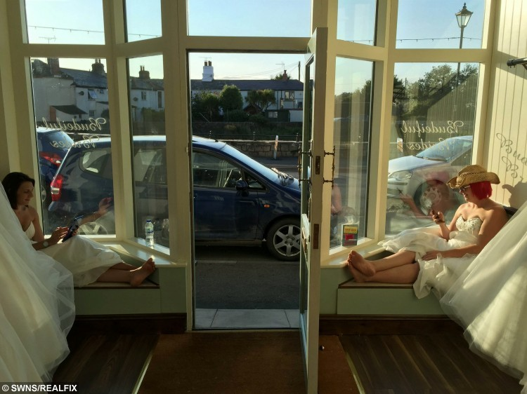 (L-R)  Tara Attis, 32, and Kate Holder, 27, in the shop window of Budeiful Bridal, Bude, Cornwall. See SWNS story SWBRIDE; Two women spent more than 50 hours dressed as mannequins in a shop window wearing bridal gowns - in a bid to win a dream wedding. Determined Kate Holder and Tara Attis, 32, dressed as mannequins and stood on display in a 1ft x 3ft window space for two and a half days.  They stood still in Budeiful Bridal shop window with whoever could stay the longest winning a dream wedding.  Kate ending up the eventual winner after Tara finally stepped down late on Monday night after 58 and a half hours - with only the odd toilet break.