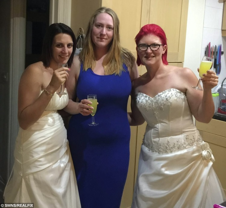 (L-R) Tara Attis, 32, with shop owner, Emily Benny, and competitor, Kate Holder, 27, Cornwall. See SWNS story SWBRIDE; Two women spent more than 50 hours dressed as mannequins in a shop window wearing bridal gowns - in a bid to win a dream wedding. Determined Kate Holder and Tara Attis dressed as mannequins and stood on display in a 1ft x 3ft window space for two and a half days.  They stood still in Budeiful Bridal shop window with whoever could stay the longest winning a dream wedding.  Kate ending up the eventual winner after Tara finally stepped down late on Monday night after 58 and a half hours - with only the odd toilet break.