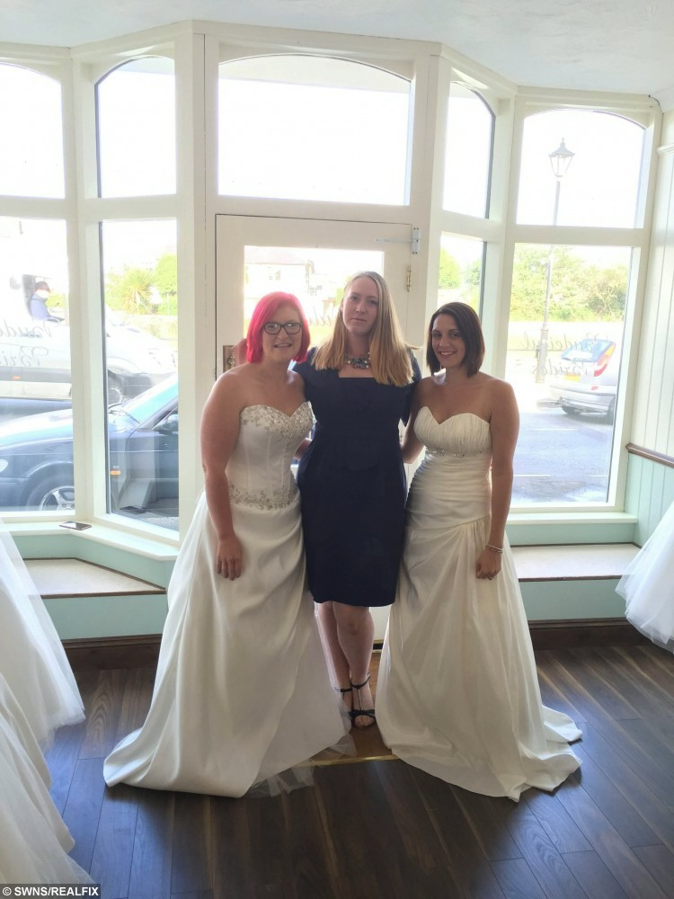 (L-R)  Kate Holder, 27, Emily Benny, and Tara Attis, 32 in Budeiful Bridal, Bude, Cornwall. See SWNS story SWBRIDE; Two women spent more than 50 hours dressed as mannequins in a shop window wearing bridal gowns - in a bid to win a dream wedding. Determined Kate Holder and Tara Attis, 32, dressed as mannequins and stood on display in a 1ft x 3ft window space for two and a half days.  They stood still in Budeiful Bridal shop window with whoever could stay the longest winning a dream wedding.  Kate ending up the eventual winner after Tara finally stepped down late on Monday night after 58 and a half hours - with only the odd toilet break.