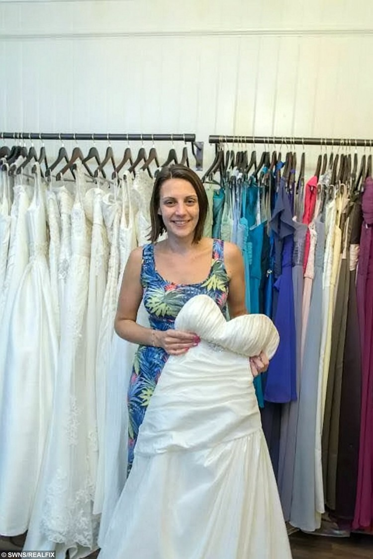 Tara Attis, 32, who took part in a bridal competition pictured at Budeiful Bridal, Bude, Cornwall. See SWNS story SWBRIDE; Two women spent more than 50 hours dressed as mannequins in a shop window wearing bridal gowns - in a bid to win a dream wedding. Determined Kate Holder and Tara Attis, 32, dressed as mannequins and stood on display in a 1ft x 3ft window space for two and a half days.  They stood still in Budeiful Bridal shop window with whoever could stay the longest winning a dream wedding.  Kate ending up the eventual winner after Tara finally stepped down late on Monday night after 58 and a half hours - with only the odd toilet break.