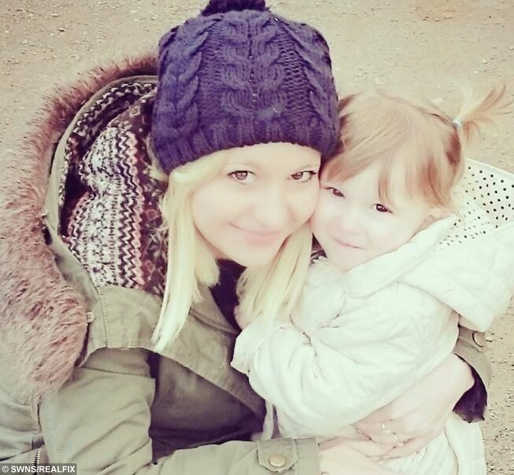 """Brave Abi Rounds pictured with her daughter Ruby May. See SWNS story SWVIDEO; A young mum who was diagnosed with breast cancer aged just 22 broke the news to her family and friends - via a viral FACEBOOK video. Brave Abi Rounds, now 23, feared the worst when doctors told her she had two cancerous lumps last year but quickly decided she would """"kick cancer's butt"""". The stunning mum - who had watched her own mother and aunt fight the disease - was shocked by the diagnosis but wanted to let all her friends know at the same time. She made an online video breaking the devastating news to her pals, but vowing to do everything it takes to beat the disease with the support of her friends and family"""