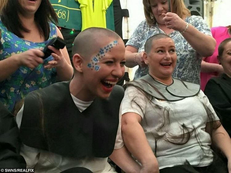"""Brave Abi Rounds (left) pictured with friends on the day she shaved her hair prior to chemotherapy. See SWNS story SWVIDEO; A young mum who was diagnosed with breast cancer aged just 22 broke the news to her family and friends - via a viral FACEBOOK video. Brave Abi Rounds, now 23, feared the worst when doctors told her she had two cancerous lumps last year but quickly decided she would """"kick cancer's butt"""". The stunning mum - who had watched her own mother and aunt fight the disease - was shocked by the diagnosis but wanted to let all her friends know at the same time. She made an online video breaking the devastating news to her pals, but vowing to do everything it takes to beat the disease with the support of her friends and family"""