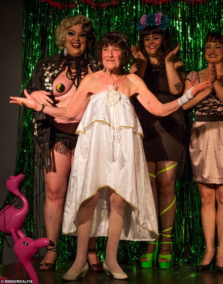 Lynn Ruth Miller, 81, from Brighton, with other performers at Bristol Burlesque Festival at Rip Roar Comedy club, Bristol. See SWNS story SWDANCE: The world's oldest burlesque dancer has just finished her summer tour aged 81 - and she only started stripping off a decade ago. Glamorous Lynn Ruth Miller took up performing aged 71 when she enrolled on a stand-up comedy class to write a story about learning to be funny. But she soon realised she had the ability to make people laugh and started touring American and the UK telling jokes. A year later the twice-married pensioner decided to incorporate burlesque and stripping into her routine and instantly started winning awards for her unique show.