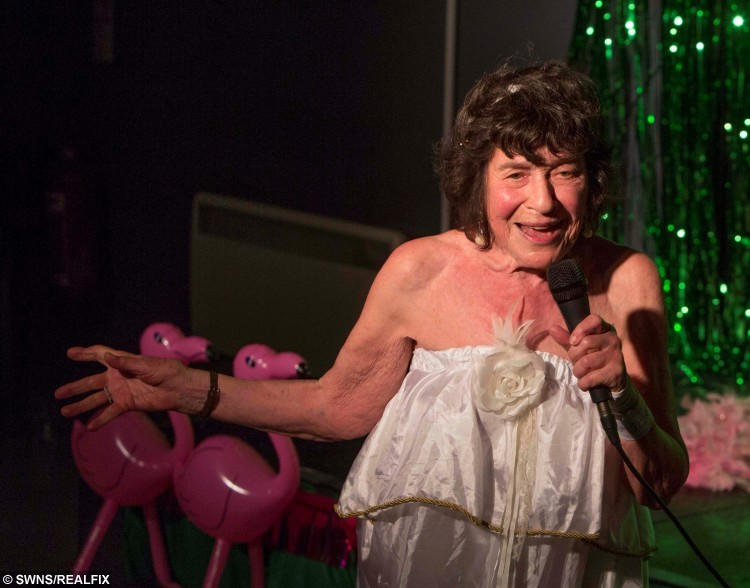 Lynn Ruth Miller, 81, burlesque dancer, from Brighton, performing at Bristol Burlesque Festival at Rip Roar Comedy club, Bristol. See SWNS story SWDANCE: The world's oldest burlesque dancer has just finished her summer tour aged 81 - and she only started stripping off a decade ago. Glamorous Lynn Ruth Miller took up performing aged 71 when she enrolled on a stand-up comedy class to write a story about learning to be funny. But she soon realised she had the ability to make people laugh and started touring American and the UK telling jokes. A year later the twice-married pensioner decided to incorporate burlesque and stripping into her routine and instantly started winning awards for her unique show.