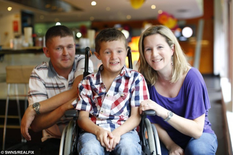 Louise and Steve Coleman with son Tommy enjoy a meal at Yo Sushi restaurant in London. See SWNS story SWSUSHI; An eight-year-old boy with a rare muscle disease is fighting back with a super-sized high-energy diet - including salmon and SUSHI for breakfast. Little Tommy Coleman has Duchenne muscular dystrophy which causes his muscles to weaken and waste, as well as a heart condition which means he burns up lots of energy. It means that while the lad is the same size as any boy his age, he eats more than a grown man - an estimated 3,000 calories - including FOUR meals a day and two puddings. And while most kids are tucking into a bowl of cereal, foodie Tommy kick-starts every day with a full plate of his favourite food sushi, to keep his tiredness at bay.