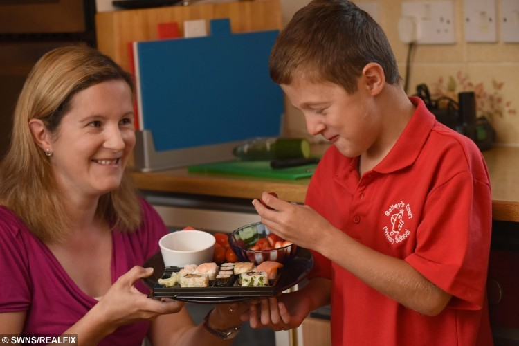 Breakfast sushi - Louise Coleman with her son Tommy at the family home in Bristol. See SWNS story SWSUSHI; An eight-year-old boy with a rare muscle disease is fighting back with a super-sized high-energy diet - including salmon and SUSHI for breakfast. Little Tommy Coleman has Duchenne muscular dystrophy which causes his muscles to weaken and waste, as well as a heart condition which means he burns up lots of energy. It means that while the lad is the same size as any boy his age, he eats more than a grown man - an estimated 3,000 calories - including FOUR meals a day and two puddings. And while most kids are tucking into a bowl of cereal, foodie Tommy kick-starts every day with a full plate of his favourite food sushi, to keep his tiredness at bay. *** Local Caption *** Sushi boy Tommy Coleman Breakfast sushi - Louise Coleman with her son Tommy at the family home in Bristol. See SWNS story SWSUSHI; An eight-year-old boy with a rare muscle disease is fighting back with a super-sized high-energy diet - including salmon and SUSHI for breakfast. Little Tommy Coleman has Duchenne muscular dystrophy which causes his muscles to weaken and waste, as well as a heart condition which means he burns up lots of energy. It means that while the lad is the same size as any boy his age, he eats more than a grown man - an estimated 3,000 calories - including FOUR meals a day and two puddings. And while most kids are tucking into a bowl of cereal, foodie Tommy kick-starts every day with a full plate of his favourite food sushi, to keep his tiredness at bay.