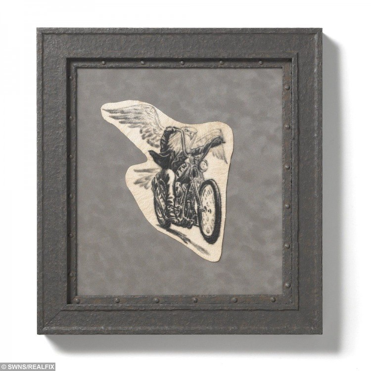 An example of Charles Hamm's framed tattoo service. See SWNS story SWTATTOO; A tattoo artist is offering a new service to clients - removing and framing pieces of inked skin from body art lovers after they DIE. When a tattoo enthusiast dies, their mourning relatives notify Save My Ink, who cut the tattoo out of their body and preserve it - skin and all. It is then put through a chemical and enzymatic process to permanently alter the chemical structure of the tissue and stop it from decaying. The effect is that the ink pops out even more than it does on the body - making for a perfect piece of art to hang on the wall forever.