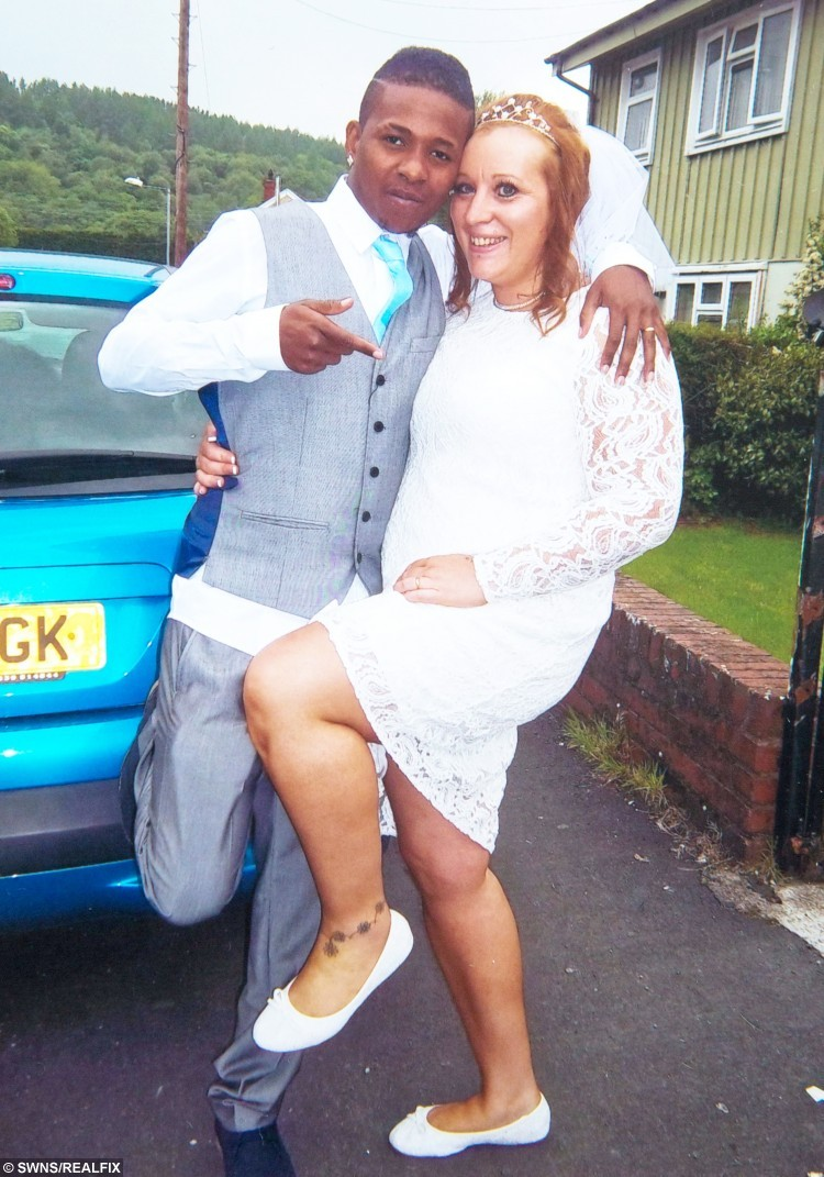 """Collect photograph of Angharad Bullock, and her husband Loric on their wedding day in May 2014. See SWNS story SWTOYBOY; A British mum who got pregnant by her teenage Jamaican toyboy says their relationship is the """"real deal"""" - even though he gets mistaken for her daughter's BOYFRIEND. Telesales worker Angharad, 38, fell head over heels for Loric, then 19, after a friend set them up and they started chatting over Blackberry Messenger. After six months of talking on Skype, the mum went on a three-week holiday to Jamaica to meet her mysterious lover in the flesh - and fell pregnant with his child. Just weeks later, after saying """"I love you"""", Loric proposed via text - and Angharad said yes, so that he could secure a permanent visa to stay in the UK."""