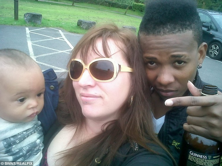 """Collect photo of Angharad Bullock, 38, her husband Loric, 22, and their child Tyrese. See SWNS story SWTOYBOY; A British mum who got pregnant by her teenage Jamaican toyboy says their relationship is the """"real deal"""" - even though he gets mistaken for her daughter's BOYFRIEND. Telesales worker Angharad, 38, fell head over heels for Loric, then 19, after a friend set them up and they started chatting over Blackberry Messenger. After six months of talking on Skype, the mum went on a three-week holiday to Jamaica to meet her mysterious lover in the flesh - and fell pregnant with his child. Just weeks later, after saying """"I love you"""", Loric proposed via text - and Angharad said yes, so that he could secure a permanent visa to stay in the UK."""