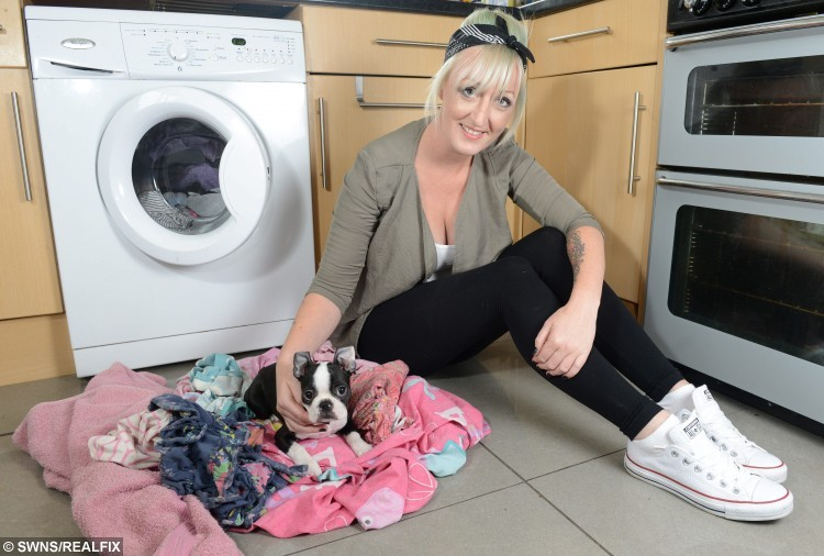 Christine Edwards from Chester, Cheshire, and her Boston Terrier Penny. Penny survived being found in a tumble dryer after 30 minutes. See SWNS Copy SWDRYER : A tiny puppy had a miracle escape after he survived being put in a tumble dryer - for 30 MINUTES. Penny the Boston Terrier was innocently popped in the machine by toddler Sienna Edwards, two, who unknowingly shut the door. Her mum Christine, 31, had no idea the three-month-old pup was inside and eldest Megan, 14, turned on the dryer which was filled with damp clothes. But half an hour later the mum-of-three was horrified when she realised tiny Penny was missing. She hauled open the tumble dryer door and found the baking hot dog amongst the sheets, and rushed him up to the bath where she held the limp pup under the cold tap. Panicked Christine bundled her into the car and drove straight to the vets where experts hooked him up to a drip and told the devastated mum to prepare for the worst. But miraculously the pooch escaped with just a burnt tummy, mouth and eye, and after a two-day stay at the vets was back to her normal happy self.