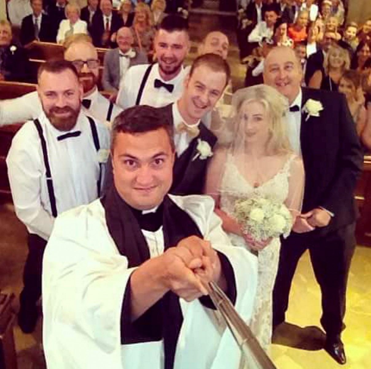 Vicar stuns bride at the alter by pulling out his SELFIE STICK!