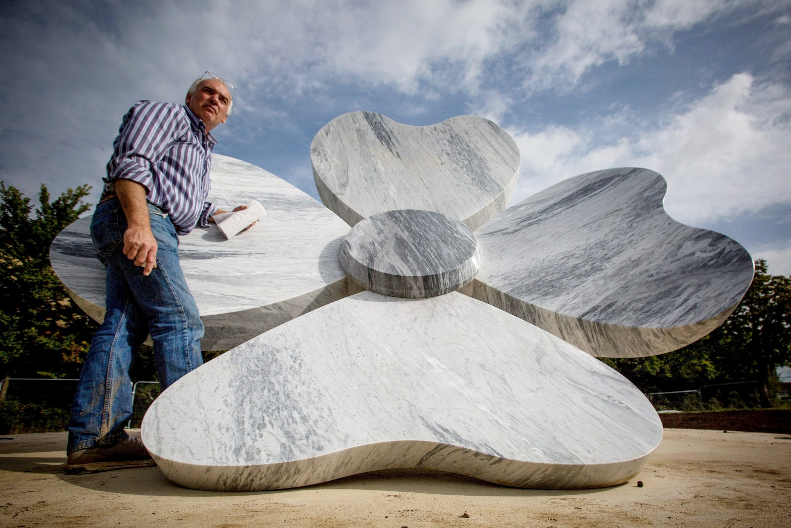Marble poppy sculpted for town to remember how they honoured our fallen heroes