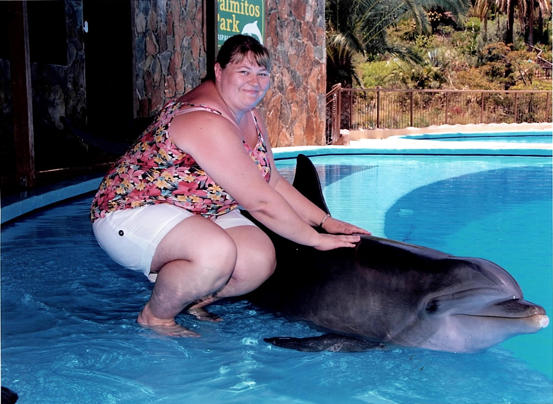 The woman who changed her life after posing for photo with a dolphin