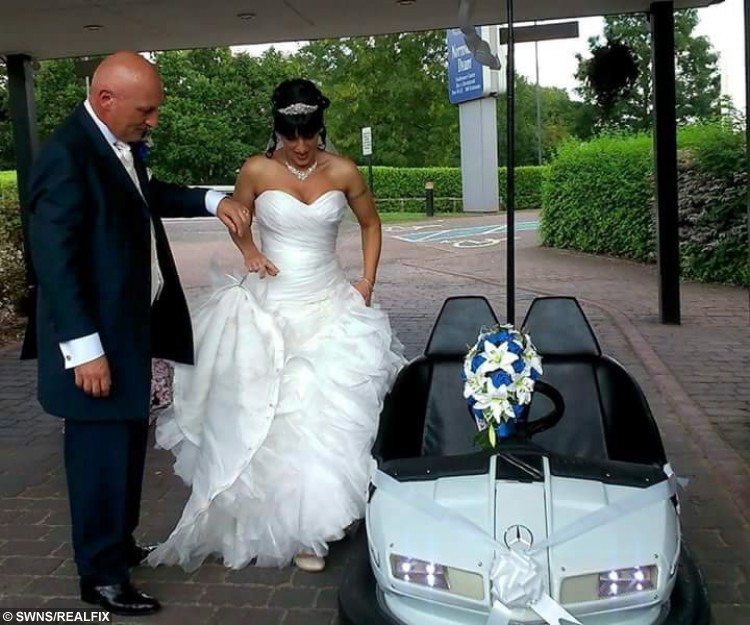 Collect of Jackie and Ray Naylor on their big day were they used a converted dodgem as their wedding car. The bumper car was put together by the bride's brother Paul Ward. See Masons story MNBUMPER; A couple had a bumpy start to their marriage when they turned up to their wedding reception in a dodgem. Jackie Naylor, 47, and husband Ray, 50, spurned the traditional horse-drawn carriage or limousine when they got hitched. Their carriage was instead provided by the brideÃs brother, Peter Ward, of Salmon Crescent, Minster, who has a growing collection of nearly 50 vintage bumper cars, some of which he has converted to be roadworthy. The vehicle took six weeks to get ready as it was sprayed white, had a Just Married licence plate installed, a bow tied around a Mercedes ornament on the bonnet, and tin cans tied to the back.