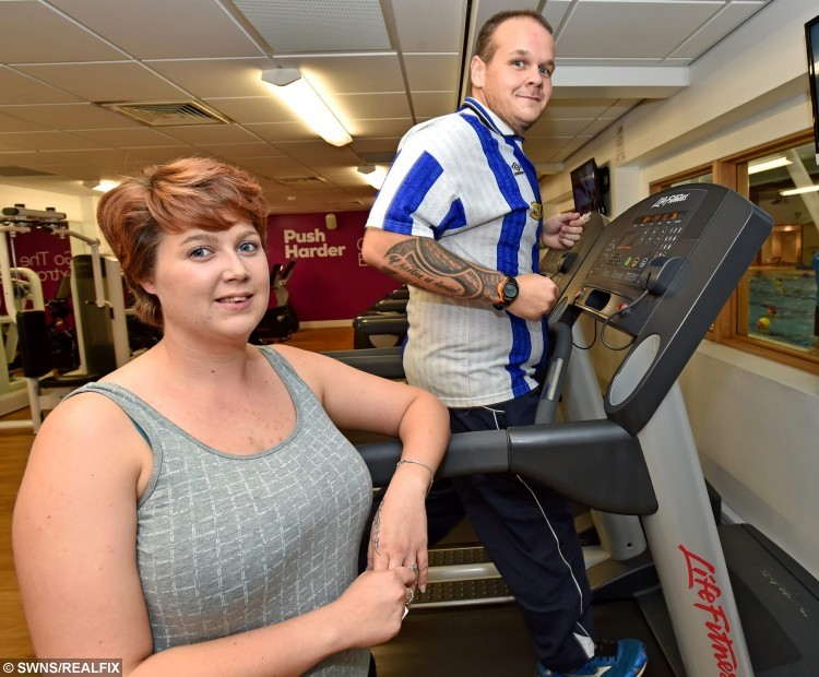 "Chris Degnan and Emma Degnan.  A Lincolnshire fast food van man lost 11st in eight months and ""re-proposed"" to his wife in front of the packed gym that helped him do it.  See NTI story NTISLIM.  Chris Degnan, from Anwick - near Sleaford, Lincs, weighed a whopping 27st this time last year but decided to slim down after doctors said he should undergo a gastric band operation in February.  After he was told what the procedure involved and what the risks were, 31-year-old Chris decided the easier option would be to join his local gym.  Now, eight months on, Chris has dropped down to 16st and lost six clothes sizes - and in celebration decided to ""re-propose"" to his wife of eight years."