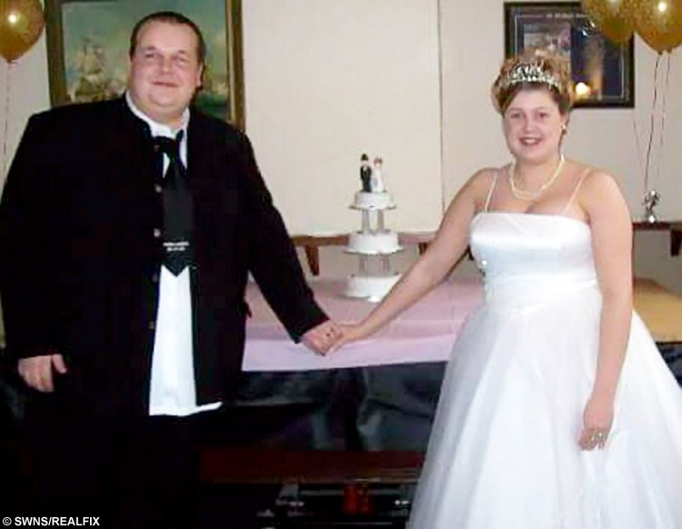 "Chris Degnan and Emma on their wedding day.  A Lincolnshire fast food van man lost 11st in eight months and ""re-proposed"" to his wife in front of the packed gym that helped him do it.  See NTI story NTISLIM.  Chris Degnan, from Anwick - near Sleaford, Lincs, weighed a whopping 27st this time last year but decided to slim down after doctors said he should undergo a gastric band operation in February.  After he was told what the procedure involved and what the risks were, 31-year-old Chris decided the easier option would be to join his local gym.  Now, eight months on, Chris has dropped down to 16st and lost six clothes sizes - and in celebration decided to ""re-propose"" to his wife of eight years."