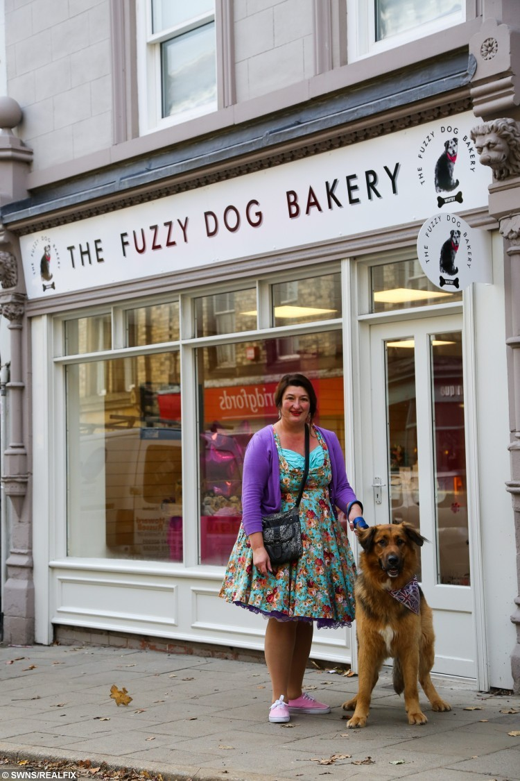 Lou Rodchenkova and her dog Jack on their way to work at The Fuzzy Dog Bakery in Whitby, North Yorkshire. It specialises in home-made treats for dogs including beefcakes, porky rolls and bloody bats. The treats, baked by Lou are free from additives and preservatives unlike many shop-bought dog treats. Owners wanting to but their dogs quality, clean products is growing in the UK. October 26 2015.