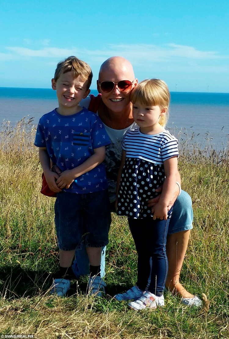Louise Hamilton, 40 of Doncaster with son Jacob, five and daughter Brooke, three on Holiday in Lincolnshire.  See Rossparry copy RPYROW: A mum has slammed her sonÃs school for refusing to authorise a term-time holiday - despite it being the only time she could take a break from her treatment for CANCER. Louise Hamilton, 40, was diagnosed with breast cancer on March 4, and underwent an intensive course of chemotherapy and radiotherapy. Her only break in her six-month treatment came the week starting September 7 and her family wanted to take a well-deserved holiday.