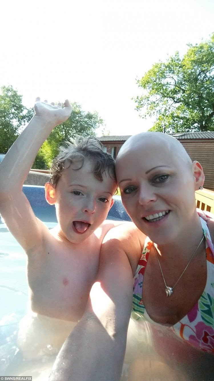 Louise Hamilton, 40 of Doncaster with son Jacob, five on Holiday in Lincolnshire.  See Rossparry copy RPYROW: A mum has slammed her sonÃs school for refusing to authorise a term-time holiday - despite it being the only time she could take a break from her treatment for CANCER. Louise Hamilton, 40, was diagnosed with breast cancer on March 4, and underwent an intensive course of chemotherapy and radiotherapy. Her only break in her six-month treatment came the week starting September 7 and her family wanted to take a well-deserved holiday.