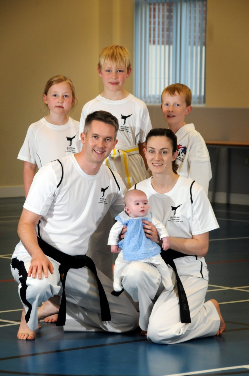 Chloe Bevan, 29, with baby Freya and partner Elliott Walker.