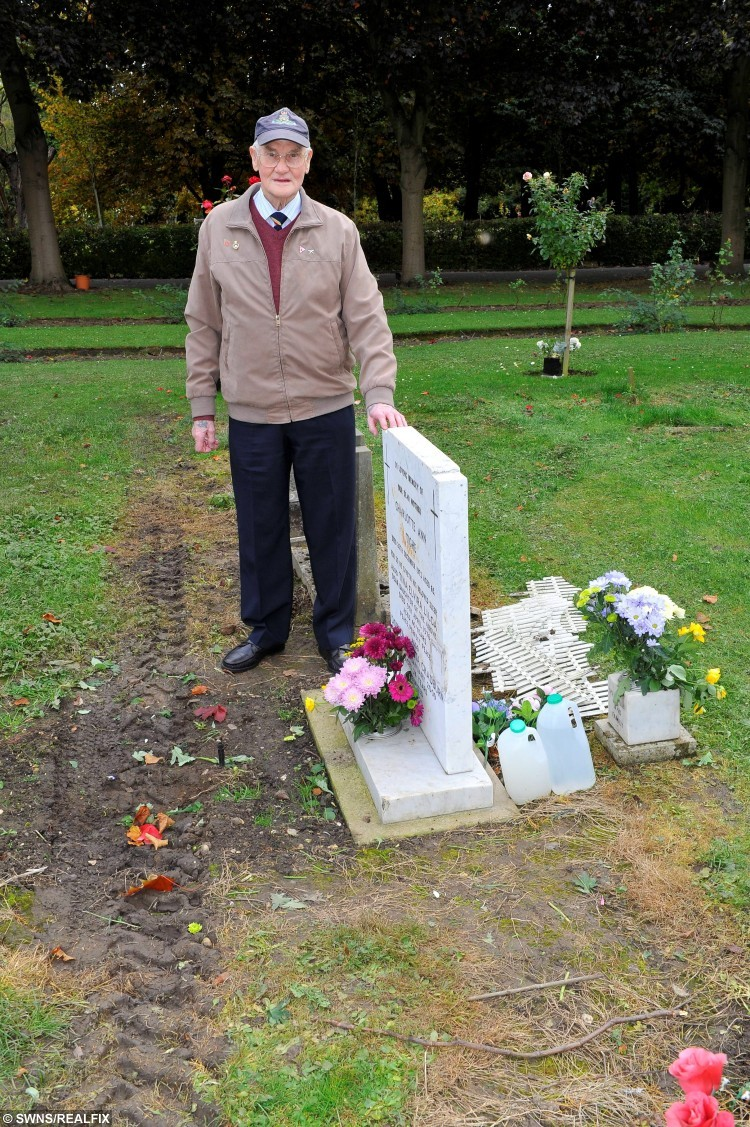 Ronald Chadburn at the grave of his wife Doreen and her family.  Ronald is appalled at the damage to the grounds around the grave and all the flowers had been moved. See Ross Parry copy RPYTYRE : A pensioner has spoken of his horror at seeing a huge tyre track across his late wife's grave. Ronald Chadburn, 75, visits the grave of his late wife, Doreen, every fortnight to lay a fresh bunch of flowers. The plot also includes other members of his wife's family, including her late father and mother and her sister, while her brother's ashes are also scattered there. Since her death six years ago, Mr Chadburn, from Hull, East Yorks., has maintained the grave on behalf of his late wife's family. He has even constructed a small wooden fence near the headstone and cuts the grass himself in Hull's Northern Cemetery. But on Saturday (October 17) he was left speechless at the sight of a large compacted tyre track running along a row of graves, including his wife's.