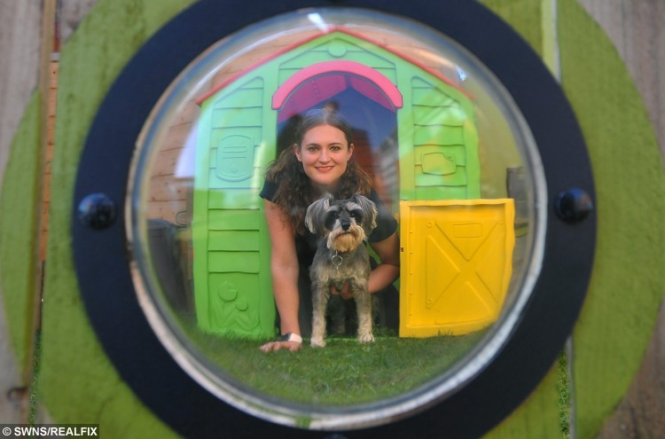 DogMore Play is a new dog creche that has opened this week at the Ocean Terminal shopping centre in Leith, Edinburgh. Pictured is manager Amy Ruickbie with Skye the miniature schnauzer. See Centre Press story CPCRECHE; Dog lovers won't have to tie up their pets outside shops any longer after the first creche at a Scots shopping centre opened its doors to the public.The play area for pooches is located at one of the busiest centres in the country and hopes to encourage shoppers to leave their dogs to play. Dogmore Play opened its doors at Ocean Terminal in Edinburgh last month and has already welcomed a number of small pets for their daily play fix. It is hoped that the creche will encourage owners to stop using leaving their dogs in the car but instead allow them to roam free in a safe environment.