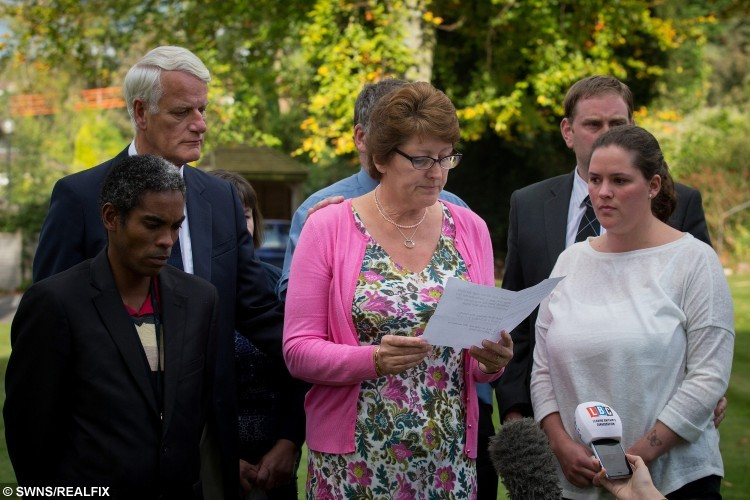 """Charlotte Bevan's mother reads out a statement to the press after the inquest into her death concludes at the Coroner's Court (centre). October 9 2015.   See SWNS story SWBEVAN: A midwife warned hospital staff she had ''grave concerns'' about a tormented mum who jumped to her death carrying her newborn baby, an inquest heard. Tragic Charlotte Bevan, 30, suffered with mental health issues for years before she walked out of a hospital with her four-day-old daughter Zaani Tiana Bevan-Malbrouck. She left a maternity ward clutching the tot and by the time the alarm was raised she had leapt to their deaths. A community midwife yesterday told an inquest she had called St Michael's Hospital in Bristol to say she had """"grave concerns"""" for the pair three days before she disappeared."""