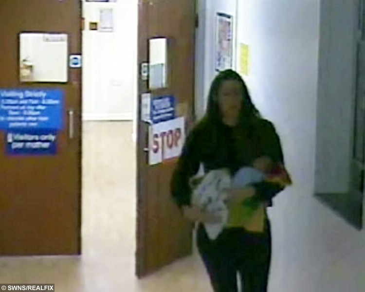 """CCTV image of Charlotte Bevan as she is seen leaving St MichaelÃs Hospital, Bristol. See SWNS story SWBEVAN: A midwife warned hospital staff she had ''grave concerns'' about a tormented mum who jumped to her death carrying her newborn baby, an inquest heard. Tragic Charlotte Bevan, 30, suffered with mental health issues for years before she walked out of a hospital with her four-day-old daughter Zaani Tiana Bevan-Malbrouck. She left a maternity ward clutching the tot and by the time the alarm was raised she had leapt to their deaths. A community midwife yesterday told an inquest she had called St Michael's Hospital in Bristol to say she had """"grave concerns"""" for the pair three days before she disappeared."""
