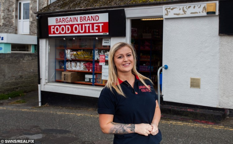 Charlotte Danks aged 20, from Newquay, Cornwall, has opened a budget supermarket in the Cornish town. The shop sells products from 25p and aims to help poor people in Cornwall. 26/10/2015 A kind-hearted young woman is taking on the supermarket giants by opening up her own store to help the poor à and is selling most items for just 25 PENCE. See swns story SWMARKET. The Bargain Brand Food outlet is stocked from floor to ceiling with food which is not up to the standard of the supermarket giants so she can sell it for virtually nothing. Most of her stock comes from the main chains, but they choose not to sell it due to manufacturing defects, such as damaged packaging or incorrect labels. Charlotte Danks, 20, of Newquay, Cornwall, launched the venture five months ago, to give cash-strapped people in her local community a more viable option then just going to food banks. The items stocked in Charlotte's store, which include fresh meat, dairy, tinned foods and even hair dye, are coming to the end of their sell-by date, but are still well within their use-by date. Most items sell for just 25 pence, with the most expensive being a two-litre tub of curry powder, at Ã2.50. The shop has been so successful that Charlotte is now planning on opening two more in St Austell and Penzance.