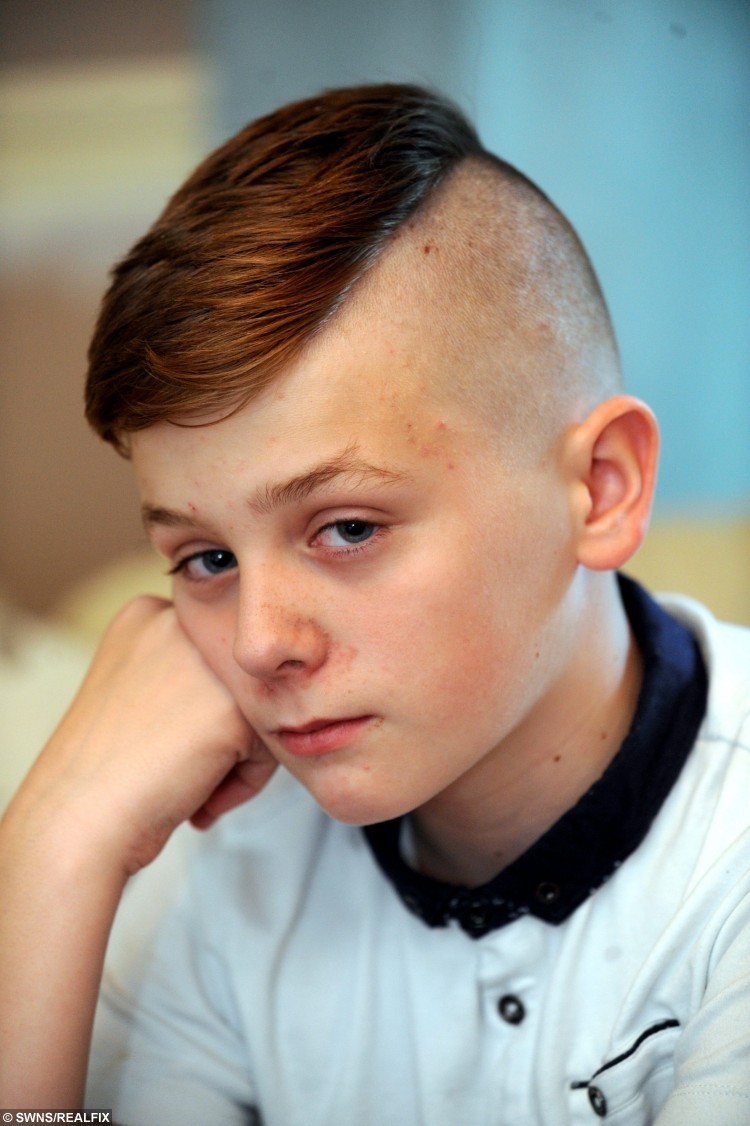 Ben Anderson a pupil at Torbridge High School who says he has been banned from going outside at breaktimes by teachers because his hair is too short. See SWNS story SWCUT: A young schoolboy has been banished from the playground à after cutting his hair short so his Sea Cadets beret would fit. Devastated Ben Anderson, 11, has now been segregated from his classmates because his school says his haircut is against the rules. Now angry mum Steph Anderson is threatening to pull the 11-year-old out of Tor Bridge High School in Plymouth, Devon, altogether. Ben, who has just started Year 7, has had to sit outside of the school office at break and lunch times since Monday.