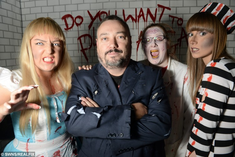 """(L-R) Chris Walton, Frankie Walton, Tracy Wilson, Jenny Needhamn, who a part of The Howick House of Terror """"Zombie Apocalypse """" attraction in Preston, Lancs., that will be open to the public on the Halloween weekend. Chris Walton from Preston, Lancs., has created the ultimate scary Halloween experience for the public to come see and by spooked by. See SWNS story SWHAUNTED; A family have spent Ã20,000 transforming their home into a real-life haunted house for a huge public Halloween party. The Waltons are expecting more than 1,000 people to attend their two-day extravaganza this weekend, and hope to raise over Ã2,000 for Cancer Research. They have built five extra temporary rooms in their driveway, converted their garage and turned their garden into a 'Zombie Apocalypse' zone with 11 themed areas. Now in its fifth year, the Howick House of Terror party makes their home in Preston, Lancashire, the most decorated in Britain. It takes the dedicated family 10 months of planning, and includes a Zombie's House, Dracula's Lair and a Haunted Carnival, with animatronics and video screens."""