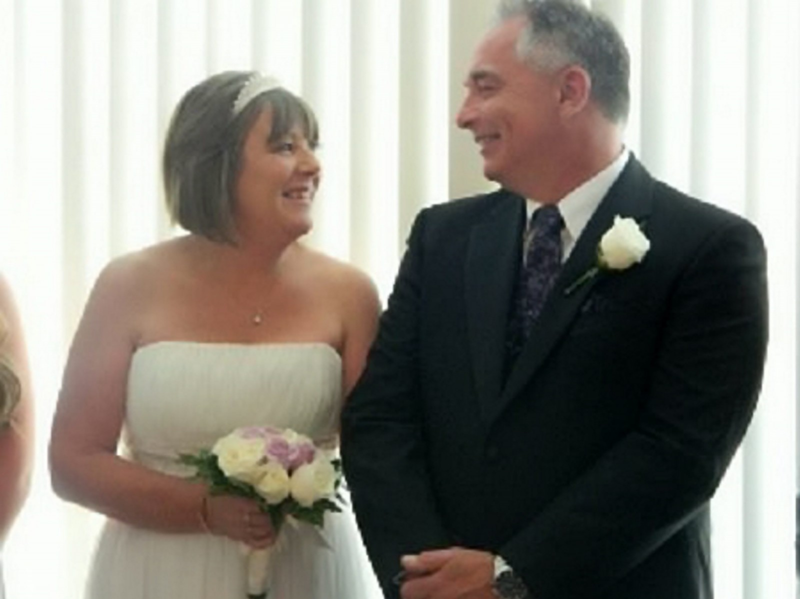 Collect picture of Ian and Carolyn on their wedding day in Adelaide, 29 December 2014. See SWNS story SWSWEET Childhood sweethearts reunited from across the globe - and finally tie the knot 35 years later. Soul mates Carolyn Cook, Nee Walker, 51 and her now husband Ian, 50, first met as teenagers in 1979. They were first loves and dated for about two years - before a devastating split when Ian's family decided to emigrate to Australia. The pair lost touch until a surprise online reunion in 2010. Carolyn left behind her life in England to rediscover her lost love and, 35 years after they met, the couple married.