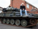 Dad forced to buy bigger home after accidentally winning a TANK in online auction!