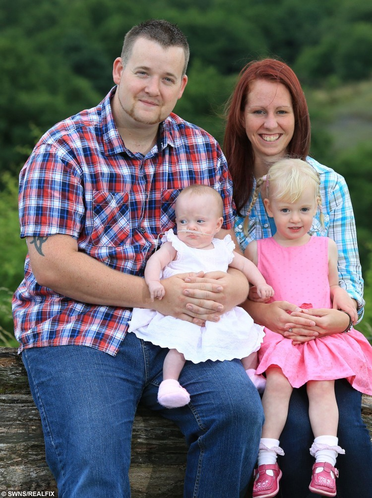 L-R, Gareth Poulsom, 27, his daughter, Esme Poulsom, 4 mths old, mum Kirsty Barrett, 24, and  Ava Poulsom, 2, Pontypool, South Wales. 13 Aug 2013 . See SWNS story SWHAND; Miracle mite Esme Poulsom has astounded medics by surviving despite being born four months premature weighing just 1lb 6oz - smaller than mother's hand. Tiny Esme was given just a one per cent chance of life when Kirsty Barrett's waters broke after just 19 weeks. But Kirsty, 24, and partner Gareth Poulsom refused to give up hope and Esme was born four months prematurely weighing just 1lb 6oz. She was so small Gareth's hand dwarfed her as she lay in neo-natal intensive care.