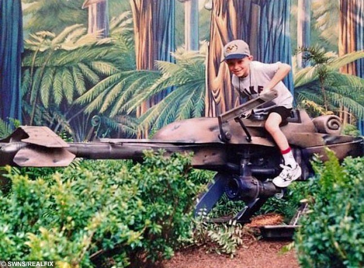 Collect of terminally ill Star Wars fan Jordan Lyons as a young boy on a Speeder Bike used in the films. Jordon from Essex, is desperate to see the new Star Wars film Episode VII - The Force Awakens. See Masons story MNWARS; A terminally ill Star Wars fan has one final request: to see Episode VII - The Force Awakens, the latest in the space-themed sci-fi saga, before he dies. Jordan Lyons, 24, was diagnosed with cystic fibrosis when he was just 15 months old. He spent his school years in and out of hospital and had a double lung transplant in 2003. Cystic fibrosis is a genetic disease caused by a faulty gene which causes the lungs and digestive system to become clogged with mucus, making it hard to breathe and digest food. Although Jordan was born after the first Star Wars film was released, in 1977, he became a huge fan after watching the series when stuck in hospital as a child. Since then he's watched each film multiple times, collects the memorabilia and knows all the trivia.